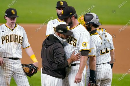 San Diego Padres manager Jayce Tingler, in jacket, takes pitcher Drew Pomeranz out of the game against the Los Angeles Dodgers during the eighth inning in Game 3 of a baseball National League Division Series, in Arlington, Texas