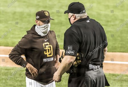 San Diego Padres manager Jayce Tingler (L) talks with home plate umpire Bill Miller (R) in the sixth inning of the National League Division Series game three between the San Diego Padres and the Los Angels Dodgers at Globe Life Field in Arlington, Texas, USA, 08 October 2020.