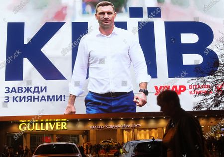 Stock Photo of A huge screen shows an election campaign ad of former boxing heavyweight world champion and current mayor of Kiev Vitali Klitschko ahead of Ukrainian local elections. Local elections in Ukraine are scheduled for October 25, 2020