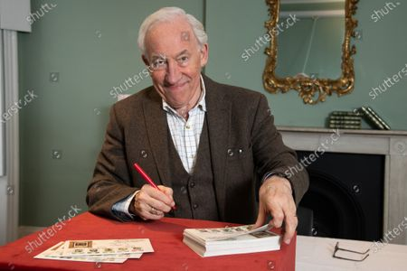 Actor Simon Callow, Patron of the Charles Dickens Museum, signing first day covers at the Charles Dickens Museum, London.  To mark the 150th anniversary of the death of Charles Dickens, the Isle of Man Post Office has worked with the Museum to publish a set of six stamps featuring five engravings from his most famous book, A Christmas Carol, and the 'lost portrait' of Dickens,  which captures him when he was in the midst of writing the book. The stamps will be published on 14 October 2020