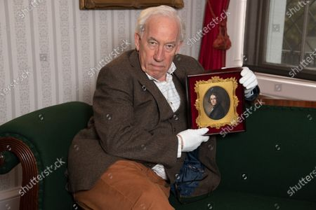 Actor Simon Callow, Patron of the Charles Dickens Museum, in Dickens's Drawing Room at the Museum with the 'lost portrait' of Charles Dickens by Margaret Gillies, showing the author at the age of 31, while he was writing A Christmas Carol.  The painting was lost for over 130 years before recently turning up in a box of trinkets in South Africa. It is now owned by the Museum. To mark the 150th anniversary of the death of Charles Dickens, the Isle of Man Post Office has worked with the Museum to publish a set of six stamps. The highest value stamp features the 'lost portrait'