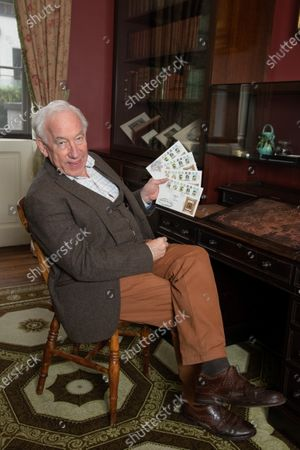 Actor Simon Callow, Patron of the Charles Dickens Museum, with first day covers in Dickens's Study at the Charles Dickens Museum, London.  To mark the 150th anniversary of the death of Charles Dickens, the Isle of Man Post Office has worked with the Museum to publish a set of six stamps featuring five engravings from his most famous book, A Christmas Carol, and the 'lost portrait' of Dickens,  which captures him when he was in the midst of writing the book. The stamps will be published on 14 October 2020