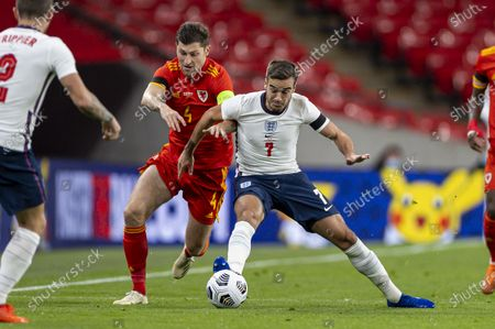 England's Harry Winks (R) vies with Wales' Ben Davies during a friendly match between England and Wales in London, Britain, on Oct. 8, 2020.