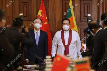 Sri Lankan Prime Minister Mahinda Rajapaksa (R) welcomes director of the Central Foreign Affairs Commission of the Chinese Communist Party Yang Jiechi (L) during their meeting in Colombo, Sri Lanka, 09 October 2020.