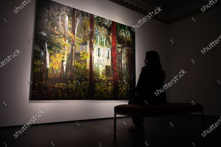 """Stock Picture of A member of staff looks at """"Boiler House"""" (estimated value £13 Million) by Peter Doig during a press preview at Christie's King Street for the Post-War and contemporary art evening auction part of the 20th Century Paris to London sale series."""