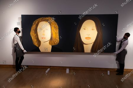 """A member of staff looks at """"Bettina and Marina"""" (estimated value £400,000-£600,000) by Alex Katz during a press preview at Christie's King Street for the Post-War and contemporary art evening auction part of the 20th Century Paris to London sale series."""
