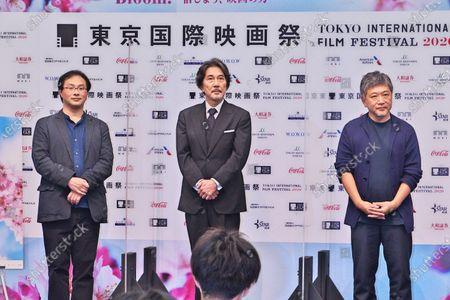 (L-R)Director Koji Fukada, actor Koji Yakusho and director Hirokazu Kore-eda attend the press conference for the Tokyo International Film Festival 2020 in Tokyo, Japan.