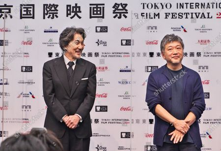 Stock Photo of Actor Koji Yakusho(L) and director Hirokazu Kore-eda attend the press conference for the Tokyo International Film Festival 2020 in Tokyo, Japan.