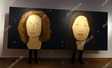 Christie's employees pose for photographers behind a painting by US artist Alex Katz, entitled 'Marina and Bettina,' in London, Britain, 09 October 2020. The artwork is expected to fetch 400,000-600,000 GBP (about 438,000-658,000 EUR) at Christie's Post-War and Contemporary Art sale on 22 October.