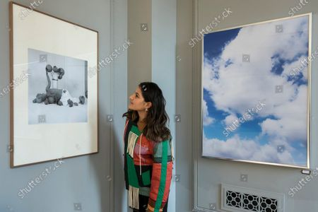 A staff member views a work by visual artist Paloma Tendero (L) with a work by Mimi Hope (R) at the launch of The House of Bandits in Mayfair - a new art and fashion space by Sarabande Foundation. The Foundation, established by the late Lee Alexander McQueen, supports and promotes creative talent. Works by a selection of the 100 artists and designers that the Foundation has supported to date are presented in this new temporary store and gallery on Vigo Street, adjoining the Burberry Regent Street store. The opening coincides with Frieze Week, and runs up to Christmas.