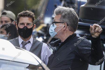 Tom Cruise (L) and US film director Christopher McQuarrie (R) wear face masks during the filming of the movie 'Mission: Impossible - Lybra' in Rome, Italy, 09 October 2020. The seventh installment in the Mission Impossible film series is to be released in 2021.