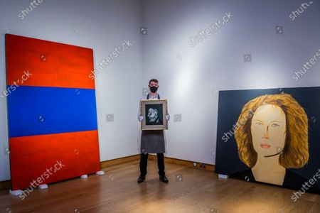 Stock Photo of Francis Bacon, Head of Man, 1959, est £4,000,000-6,000,000 with Günther Förg, Untitled, 1988, £300,000-500,000 and Alex Katz, Bettina and Marina, Painted in 2009, Est £400,000-600,000 - Christie's London preview of Post-War and Contemporary Art Evening Sale London which takes place on 22 October 2020.