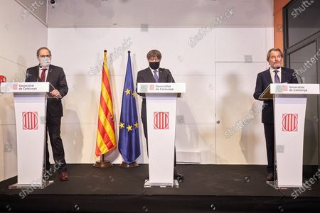 Catalan former presidents Artur Mas (R), Carles Puigdemont (C) and Quim Torra address the media during an act held at the Generalitat House in Perpignan, France, 09 October 2020. The three read a manifesto coinciding with the visit by Spanish King Felipe VI and Prime Minister Pedro Sanchez to Barcelona in which denounced a 'Spain of the repression' under the monarchy of Felipe VI with three Catalan former presidents that have ended up disqualificated or replaced.
