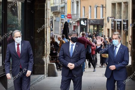 Catalan former presidents Artur Mas (R), Carles Puigdemont (C) and Quim Torra pose for photographers before addressing the media in front of the Generalitat House in Perpignan, France, 09 October 2020. The three read a manifesto coinciding with the visit by Spanish King Felipe VI and Prime Minister Pedro Sanchez to Barcelona in which denounced a 'Spain of the repression' under the monarchy of Felipe VI with three Catalan former presidents that have ended up disqualificated or replaced.