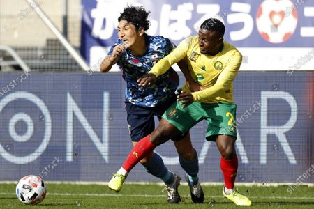 Genki Haraguchi (L) of Japan and Collins Fai of Cameroon in action during the international friendly soccer match between Japan and Cameroon at Stadion Galgenwaard in Utrecht, The Netherlands, 09 October 2020.