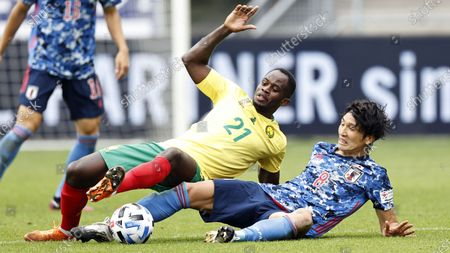 Genki Haraguchi (R) of Japan and Serge Tabekou of Cameroon in action during the international friendly soccer match between Japan and Cameroon at Stadion Galgenwaard in Utrecht, The Netherlands, 09 October 2020.