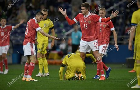 Stock Picture of Right to left: Russian national team players Yuri Gazinskiy, Alexander Sobolev and Sweden national team player Kristoffer Olsson during the match.October 08, 2020. Russia, Moscow