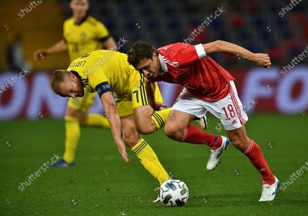 Stock Photo of Yuri Zhirkov of Russia (right) and Sebastian Larsson of Sweden (left) during the match.October 08, 2020. Russia, Moscow
