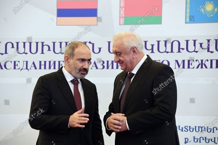 Working trip of Russian Prime Minister Mikhail Mishustin to Armenia. Prime Minister of Armenia Nikol Pashinyan (left) and Chairman of the Board of the Eurasian Economic Commission Mikhail Myasnikovich (right) during a meeting before the start of the meeting of the Eurasian Intergovernmental Council of the Eurasian Economic Union (EAEU) countries in the Karen Demirchyan sports and concert complex.October 09, 2020. Armenia, Erevan