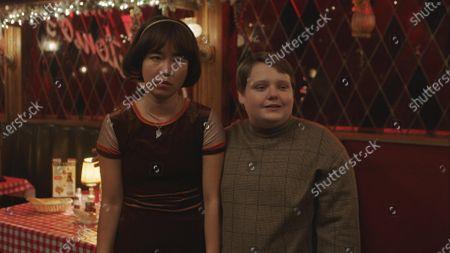 Maya Erskine as Maya Ishii-Peters and Dylan Gage as Gabe
