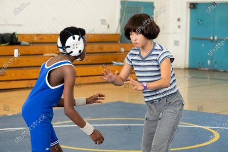 Cameron James Elie as TJ and Maya Erskine as Maya Ishii-Peters