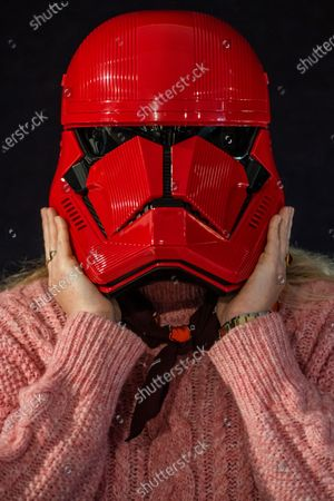 A screen-used Sith Trooper Helmet from Star Wars: The Rise Of Skywalker (2019), donated to the cause by Lucasfilm. It was created by BAFTA award-winning costume designer Michael Kaplan in a red, distinguishing the new stormtroopers from the classic, white-armoured forces of previous generations, estimate £20,000-30,000 - Preview of Bonhams' Entertainment Memorabilia sale, including a collection to be sold for the benefit of BAFTA, in Knightsbridge.