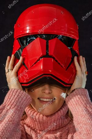 Stock Picture of A screen-used Sith Trooper Helmet from Star Wars: The Rise Of Skywalker (2019), donated to the cause by Lucasfilm. It was created by BAFTA award-winning costume designer Michael Kaplan in a red, distinguishing the new stormtroopers from the classic, white-armoured forces of previous generations, estimate £20,000-30,000 - Preview of Bonhams' Entertainment Memorabilia sale, including a collection to be sold for the benefit of BAFTA, in Knightsbridge.