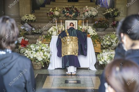 A Shinto priest pays his respects at the coffin of late Japanese fashion designer Kenzo Takada at a funeral chapel of the Pere Lachaise cemetery in Paris, France, 09 October 2020. Takada has died in a hospital in France on 04 October 2020 after suffering from Covid-19. He was 81.