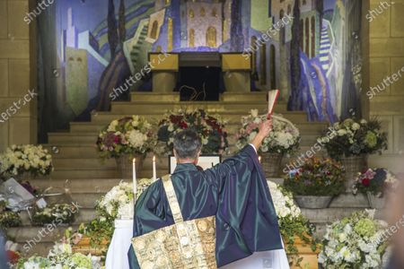 A Shinto priest performs rituals at the coffin of late Japanese fashion designer Kenzo Takada at a funeral chapel of the Pere Lachaise cemetery in Paris, France, 09 October 2020. Takada has died in a hospital in France on 04 October 2020 after suffering from Covid-19. He was 81.