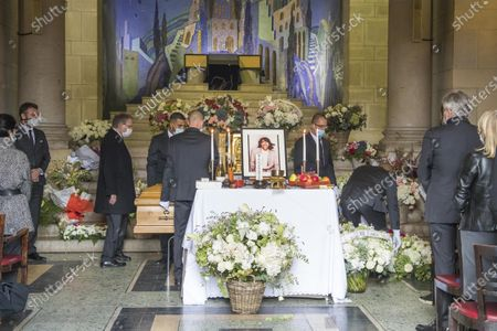 People pay their respects at the coffin of late Japanese fashion designer Kenzo Takada at a funeral chapel of the Pere Lachaise cemetery in Paris, France, 09 October 2020. Takada has died in a hospital in France on 04 October 2020 after suffering from Covid-19. He was 81.