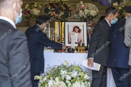 Stock Photo of People pay their respects at the coffin of late Japanese fashion designer Kenzo Takada at a funeral chapel of the Pere Lachaise cemetery in Paris, France, 09 October 2020. Takada has died in a hospital in France on 04 October 2020 after suffering from Covid-19. He was 81.