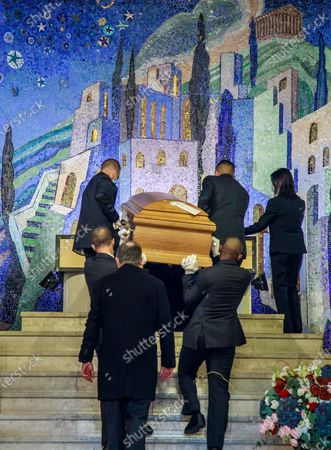Pallbearers carry the coffin of late Japanese fashion designer Kenzo Takada after a ceremony at a funeral chapel of the Pere Lachaise cemetery in Paris, France, 09 October 2020. Takada has died in a hospital in France on 04 October 2020 after suffering from Covid-19. He was 81.