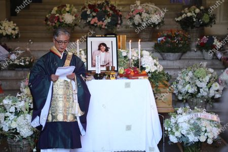 Stock Picture of A Shinto priest pays his respects at the coffin of late Japanese fashion designer Kenzo Takada at a funeral chapel of the Pere Lachaise cemetery in Paris, France, 09 October 2020. Takada has died in a hospital in France on 04 October 2020 after suffering from Covid-19. He was 81.