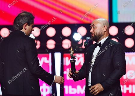 Stock Image of The main competition jury chairman, director Timur Bekmambetov (right) and documentary filmmaker Andrei Zaitsev (left)