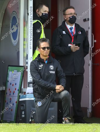 """Brighton's Manager Hope Powell  """"taking the knee"""" before the Barclays FA Women's Super League match between Brighton & Hove Albion Women and Arsenal  Women at the People's Pension Stadium in Crawley. 11 October 2020"""