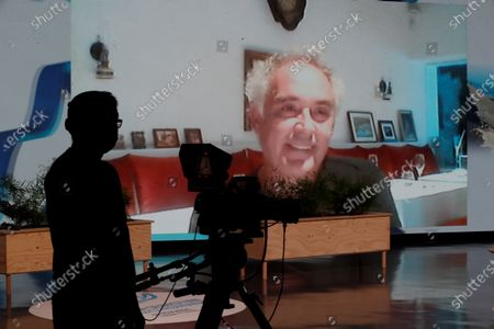 Spanish chef Ferran Adria (on the screen) participates by video conference in Gastronomika-Euskadi Basque Country gastronomic fair in San Sebastian, 09 October 2020, that focuses on bistronomy: Bistro and gastronomy, refined food, but aim to reach the general public.