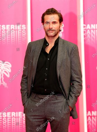 Canneseries jury member French actor Gregory Fitoussi poses on the pink carpet before the opening ceremony of the Cannes Series Festival in Cannes, France, 09 October 2020. The event runs from 09 to 14 October.