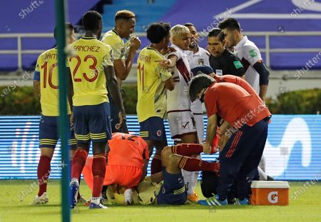 Doctors treat Colombian player Santiago Arias (C) after he was injured during a qualifying match for the Qatar 2022 World Cup, between Colombia and Venezuela in Barranquilla, Colombia, 09 October 2020.