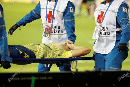 Doctors remove Colombian player Santiago Arias from the field after he was injured during a qualifying match for the Qatar 2022 World Cup, between Colombia and Venezuela in Barranquilla, Colombia, 09 October 2020.