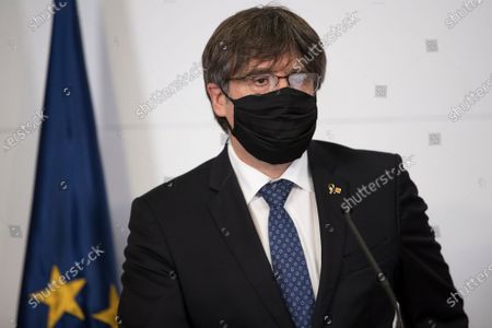 Catalonia's former regional president Carles Puigdemont attends a press conference in Perpignan, southern France, . Carles Puigdemont, Artur Mas, and Quim Torra, three former separatist-minded presidents of Spain's Catalonia region, hold a press conference in Perpignan, France, to denounce what they consider their unfair treatment by Spanish authorities