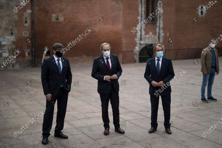 Carles Puigdemont, left, Quim Torra, center, and Artur Mas pose for a picture in Perpignan, southern France, . Carles Puigdemont, Artur Mas, and Quim Torra, three former separatist-minded presidents of Spain's Catalonia region, hold a press conference in Perpignan, France, to denounce what they consider their unfair treatment by Spanish authorities