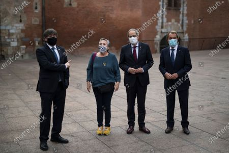 Stock Image of Supporter interrupts a posed photograph with Carles Puigdemont, left, Quim Torra, center, and Artur Mas in Perpignan, southern France, . Carles Puigdemont, Artur Mas, and Quim Torra, three former separatist-minded presidents of Spain's Catalonia region, hold a press conference in Perpignan, France, to denounce what they consider their unfair treatment by Spanish authorities