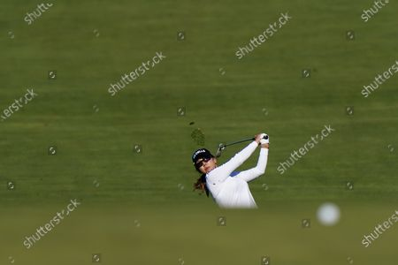 Jenny Shin, of South Korea, hits from the fairway on the 11th hole during the second round of the KPMG Women's PGA Championship golf tournament at the Aronimink Golf Club, in Newtown Square, Pa