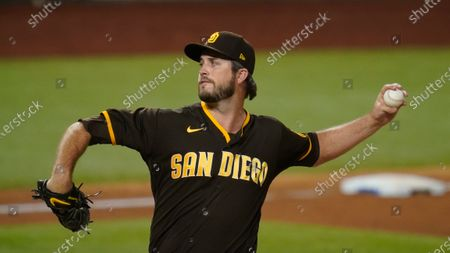 San Diego Padres' Drew Pomeranz pitches in Game 2 of a baseball National League Division Series against the Los Angeles Dodgers, in Arlington, Texas