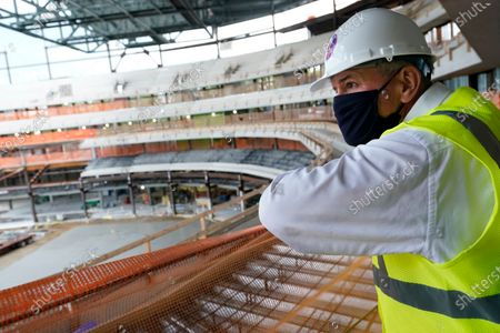 Stock Photo of Oak View Group co-founder Tim Leiweke looks over a construction fence as construction continues on the New York Islanders new UBS Arena, in Elmont, N.Y. The arena will be home to the New York Islanders NHL hockey club and will also be used for musical concerts. For hockey, the arena's capacity will be around 17,000 fans, and for concerts, around 19,000 people