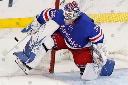 New York Rangers goaltender Henrik Lundqvist makes a save during the third period of the team's NHL hockey against the Carolina Hurricanes in New York. Lundqvist signed with the Washington Capitals when free agency opened