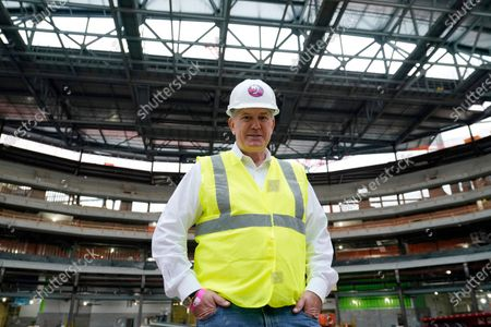 Stock Image of Oak View Group co-founder Tim Leiweke poses for a portrait on the floor of theNew York Islanders new UBS Arena, as construction continues on the New York Islanders new UBS arena, in Elmont, N.Y. Oak View Group (OVG) is a global sports and entertainment company founded by Leiweke and Irving Azoff in 2015. OVG is leading the development and operations of UBS Arena, as well as major global development projects in Seattle, WA., Austin, TX., Palm Springs, CA., Manchester, U.K. and Milan, Italy