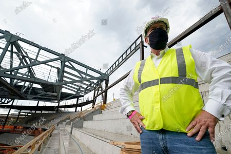 Oak View Group co-founder Tim Leiweke poses surveys the New York Islanders new UBS arena from upper tier seating area as construction continues at the site, in Elmont, N.Y. The new arena is on target to open to the public for the 2021-2022 NHL hockey season. Oak View Group (OVG) is a global sports and entertainment company founded by Leiweke and Irving Azoff in 2015