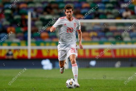 Spain's Sergi Roberto runs with the ball during the international friendly soccer match between Portugal and Spain at the Jose Alvalade stadium in Lisbon