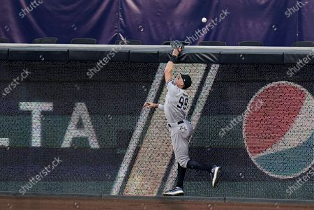 New York Yankees' Aaron Judge cannot make a catch on a home run hit by Tampa Bay Rays' Austin Meadows during the fifth inning in Game 5 of a baseball AL Division Series, in San Diego